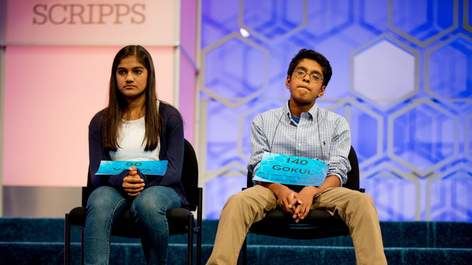 The remaining two spellers Vanya Shivashankar, left, 13, of Olathe, Kan., and Gokul Venkatachalam, 14, of St. Louis, sit onstage together during the finals of the Scripps National Spelling Bee, Thursday, May 28, 2015, in Oxon Hill, Md.