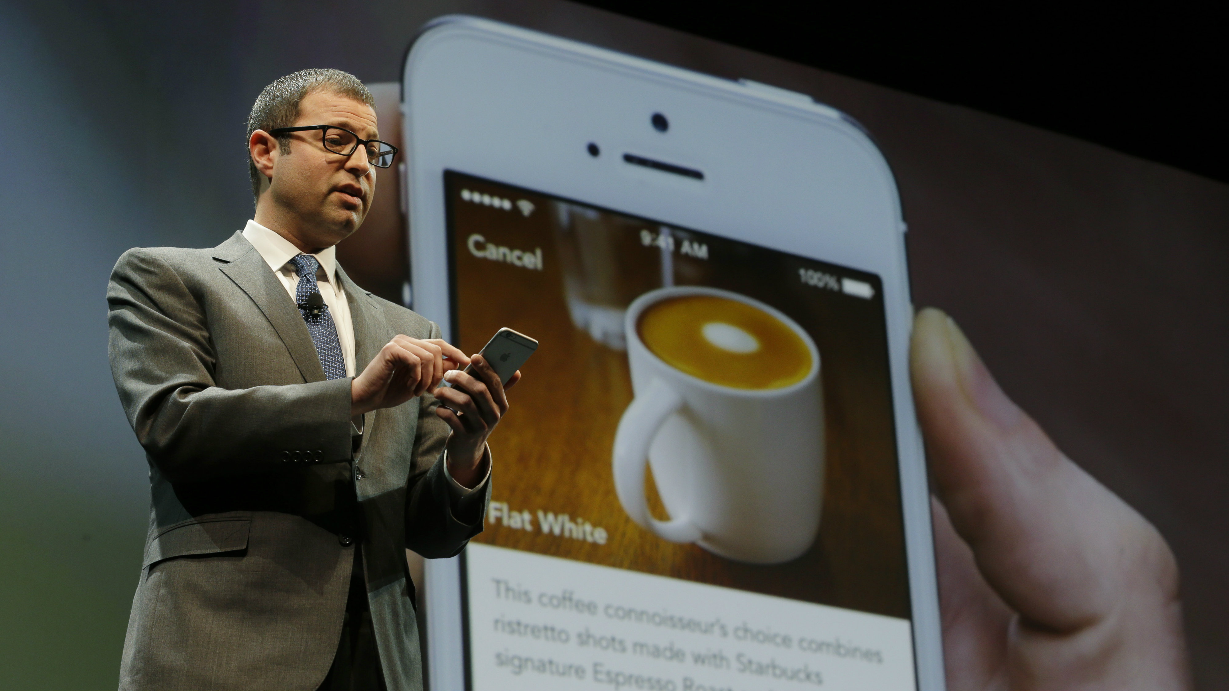Adam Brotman, Starbucks chief digital officer, talks about the company's new mobile ordering app Wednesday, March 18, 2015 at Starbucks Coffee Company's annual shareholders meeting in Seattle. (AP Photo/Ted S. Warren)