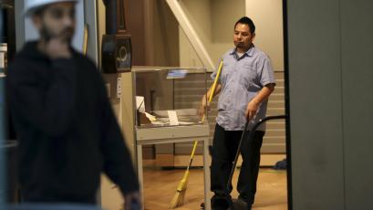 A worker sweeps inside the Wells Fargo History Museum in San Francisco, California.