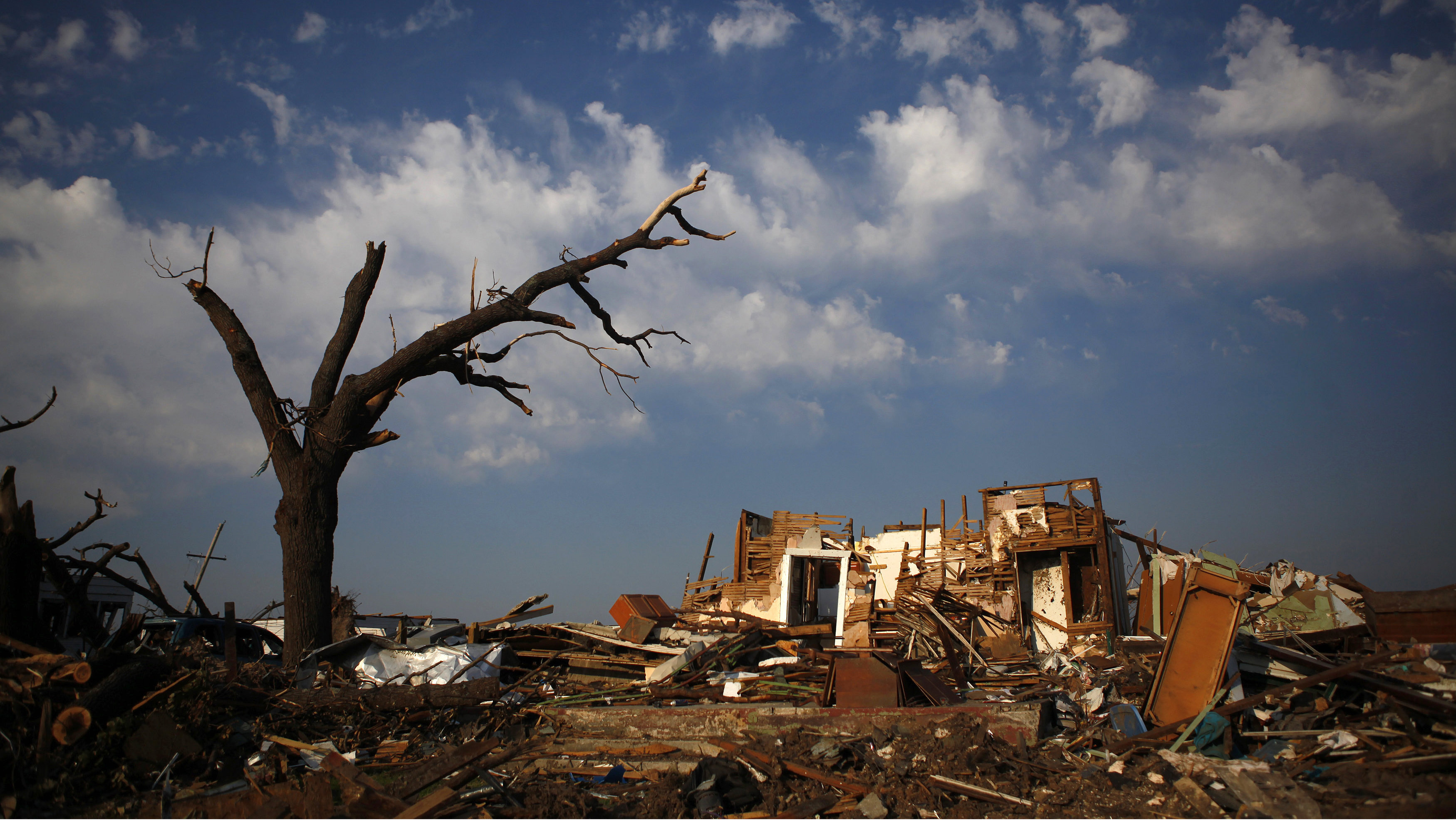 A destroyed home is seen in Joplin, Missouri May 30, 2011. A May 22, 2011 tornado in Joplin, a city of 50,000 in southwestern Missouri, was the deadliest single twister in the United States since 1947. In addition to the at least 139 people killed and more than 900 injured, scores are still unaccounted for more than a week later. The tornado churned through a stretch nearly a mile wide, damaging about 8,000 buildings in Joplin.