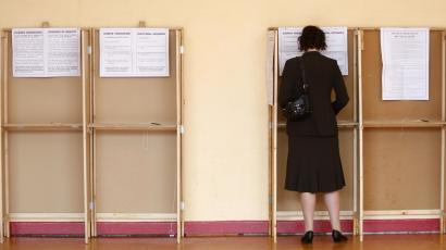 A voter fills out a ballot paper at a polling station, in Dublin on June 12, 2008