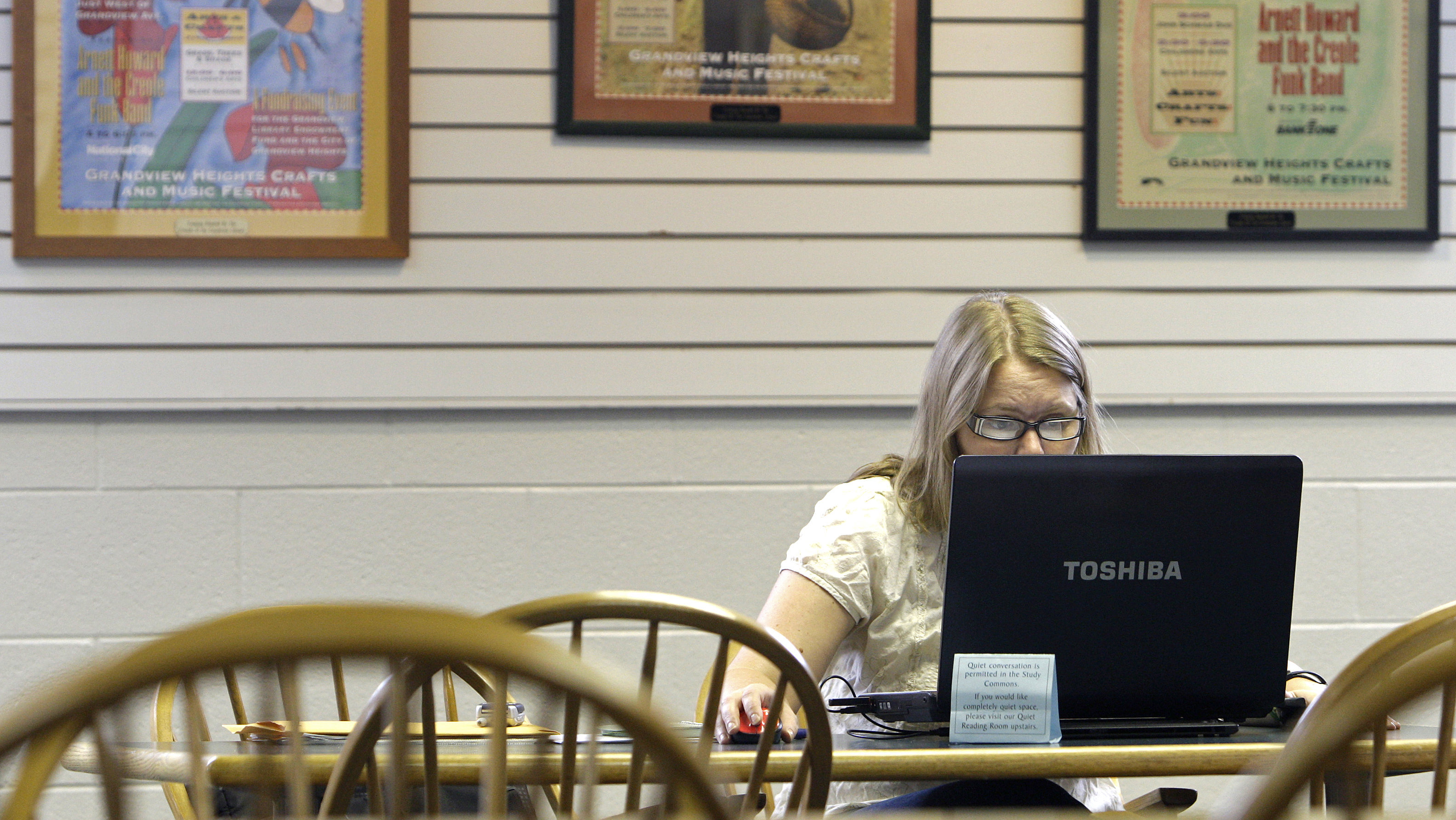 Ohio State student Lindsey Long, of Hilliard, uses the wi-fi connection at Grandview Heights Public Library Wednesday, Sept. 1, 2010, in Grandview Heights, Ohio. Long does research for her thesis at the Grandview Library.