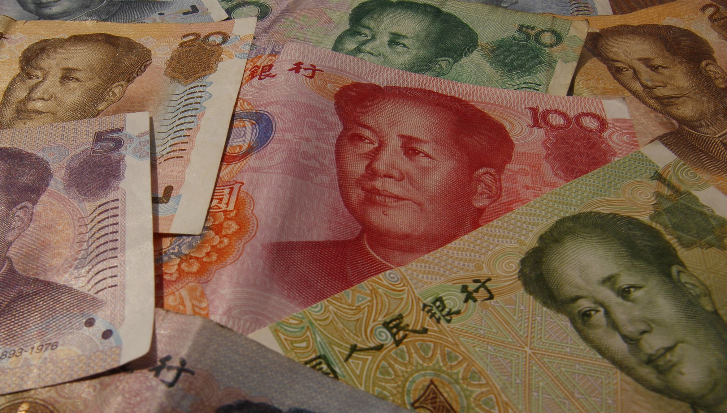 DATE IMPORTED:April 15, 2012Different values of China's yuan banknotes are seen in this photo illustration taken in Shanghai April 15, 2012. China's weekend reform of its currency regime nails shut the coffin on the last remains of doubt about whether the world's second biggest economy has successfully steered a course past a hard economic landing. To match Analysis CHINA-ECONOMY/CURRENCY REUTERS/Petar Kujundzic