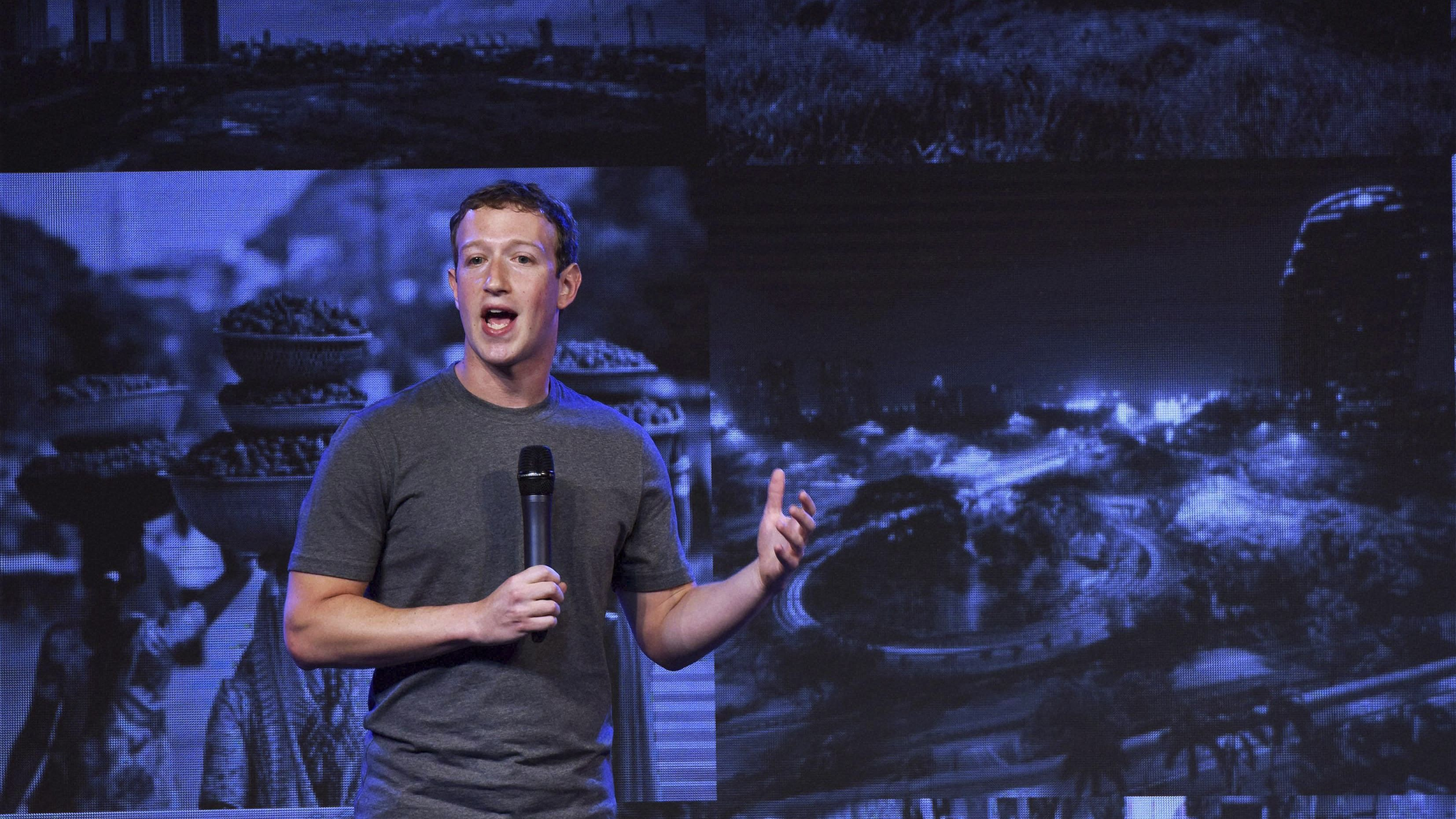 Facebook CEO Mark Zuckerberg speaks at the internet.org summit in New Delhi, India, Thursday, Oct.9, 2014. (AP Photo/Press Trust of India) INDIA OUT