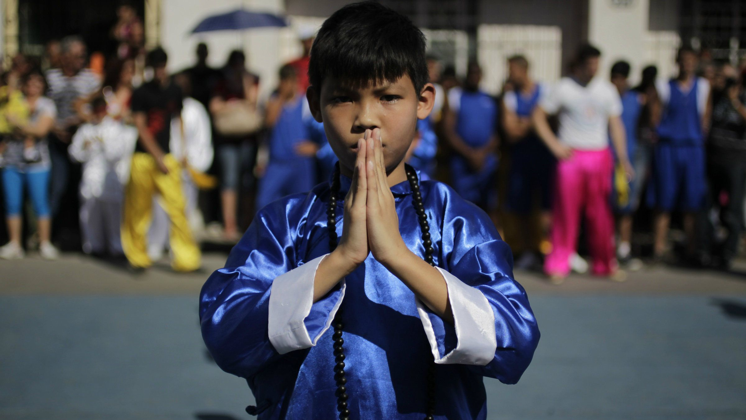 A child practices kung fu in Havana's Chinatown