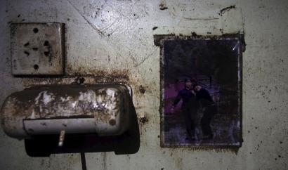 A picture is seen on the wall of a crew member dormitory inside the capsized Eastern Star cruise ship.