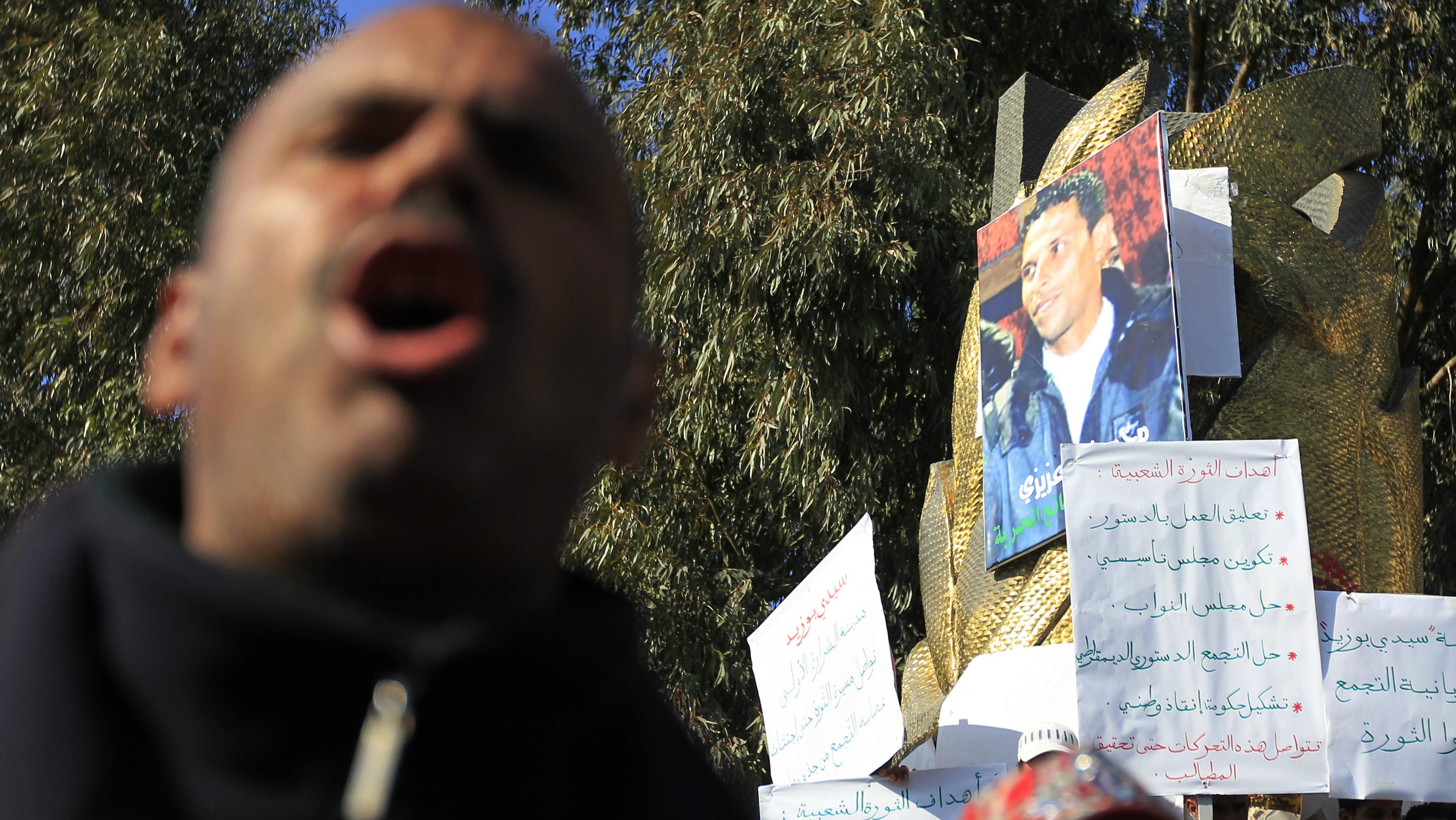 Tunisians protest near a government building where Mohamed Bouazizi set himself alight in Sidi Bouzid January 19,2011.