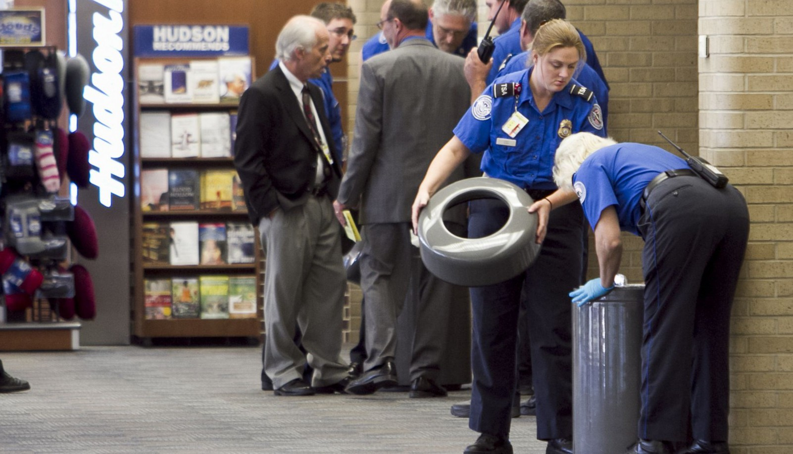 TSA agents at Omaha's Eppley Airfield search trash cans Wednesday, Aug. 3, 2011 in Omaha, Neb.. One of the terminals was evacuated and shut down when a suspicious item was spotted in a piece of luggage. The federal Transportation Security Agency says it called for the evacuation of the airport's north terminal around noon after x-ray screening workers saw an item in a carry-on bag. Officials have not said what the item was. (AP Photo/Nati Harnik)