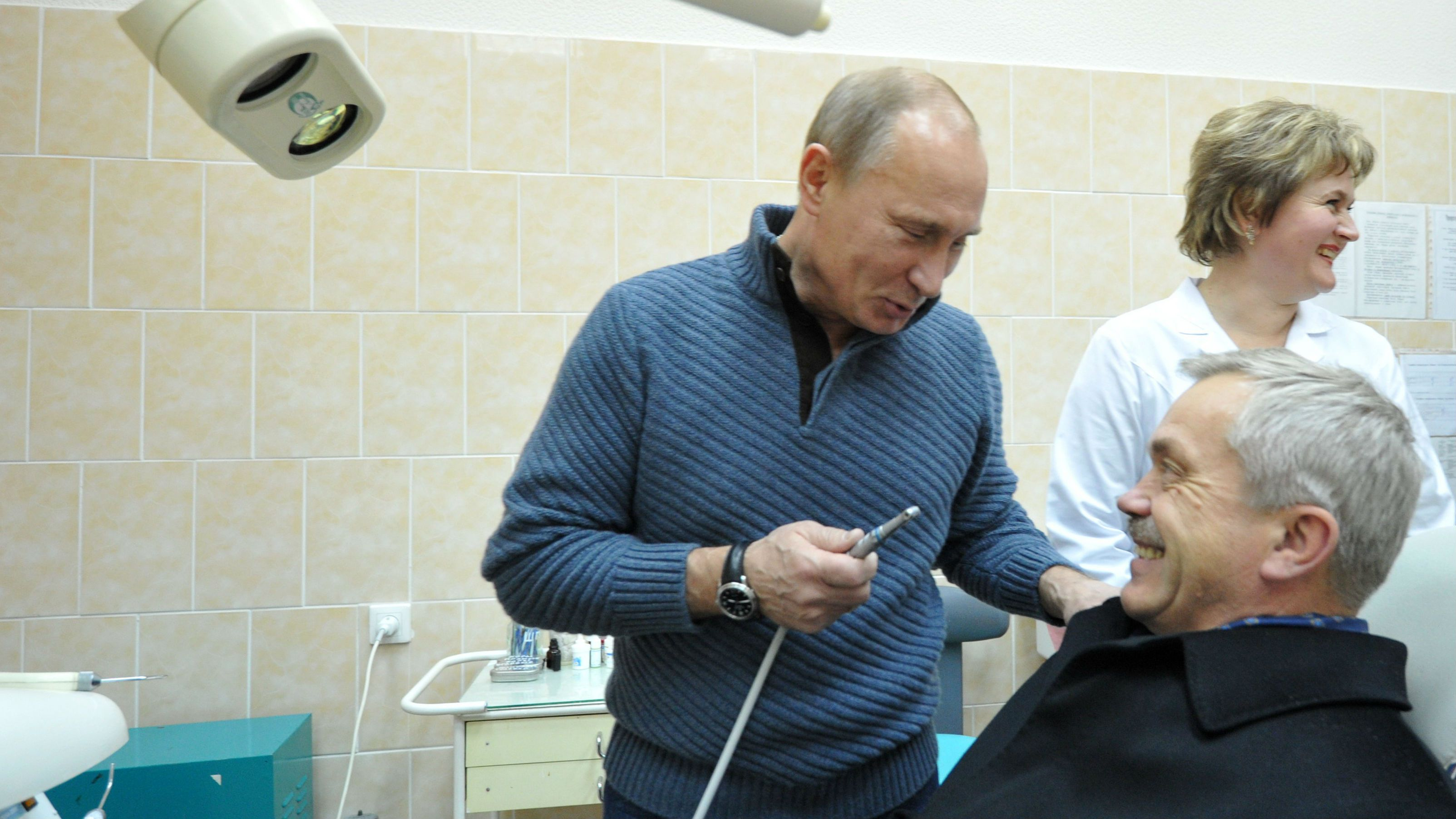 Russian Prime Minister Vladimir Putin, left, talks with Belgorod Region Governor Yevgeny Savchenko in a dental department while visiting a hospital in the town of Graivoron outside Belgorod, about 630 kilometers (400 miles) south of Moscow, Tuesday, Nov. 15, 2011. In the background is hospital head doctor Tatyana Savchenko. (AP Photo/RIA Novosti, Alexei Nikolsky, Pool)