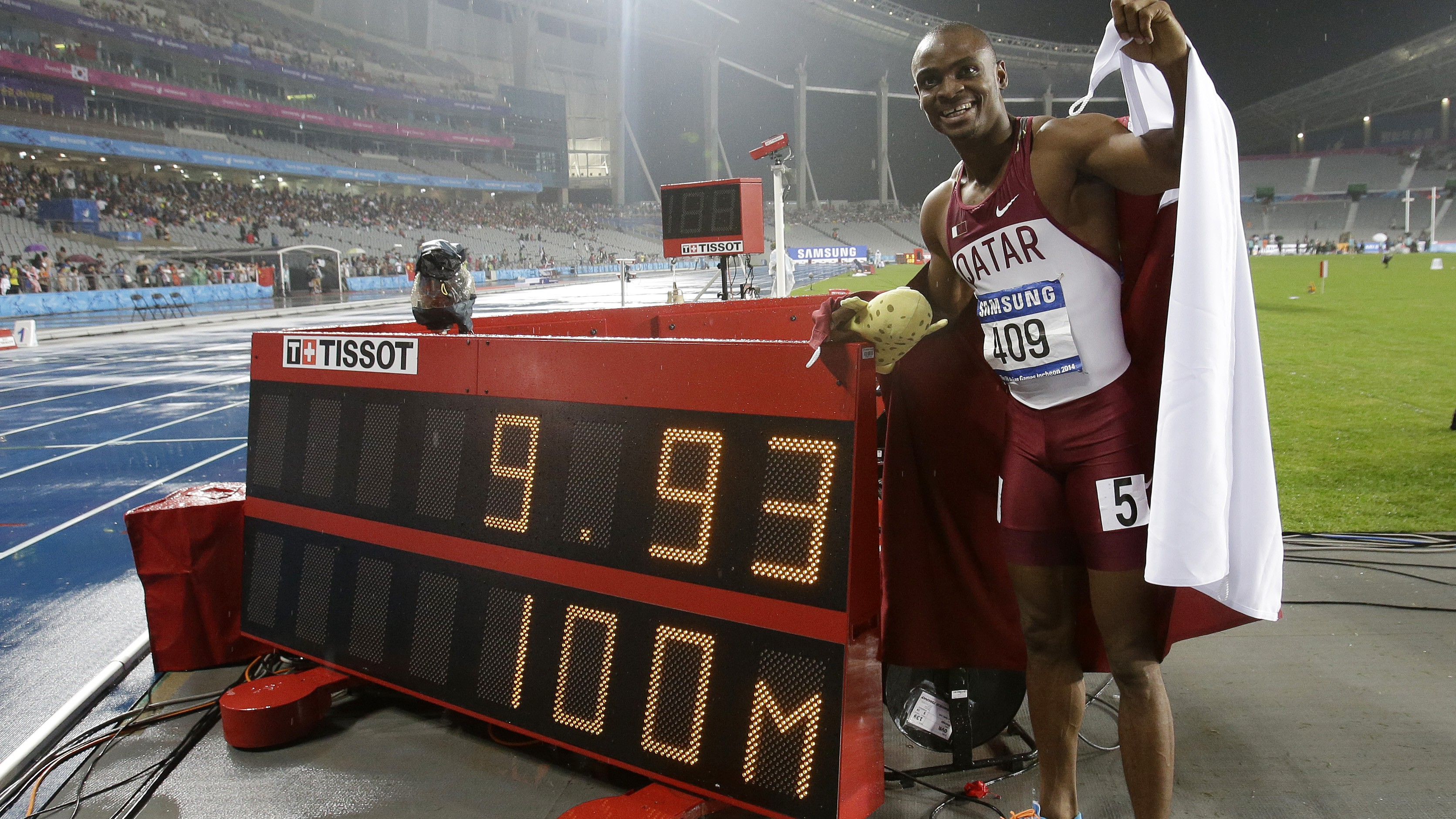 Qatar's Femi Ogunode stands by his race time after setting a games record in winning the men's 100 meters final at the 17th Asian Games in Incheon, South Korea, Sunday, Sept. 28, 2014. (AP Photo/Lee Jin-man)