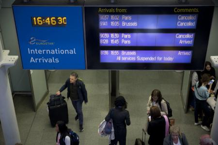 An information board shows Eurostar trains are canceled at St Pancras station in London, Tuesday, June 23, 2015.