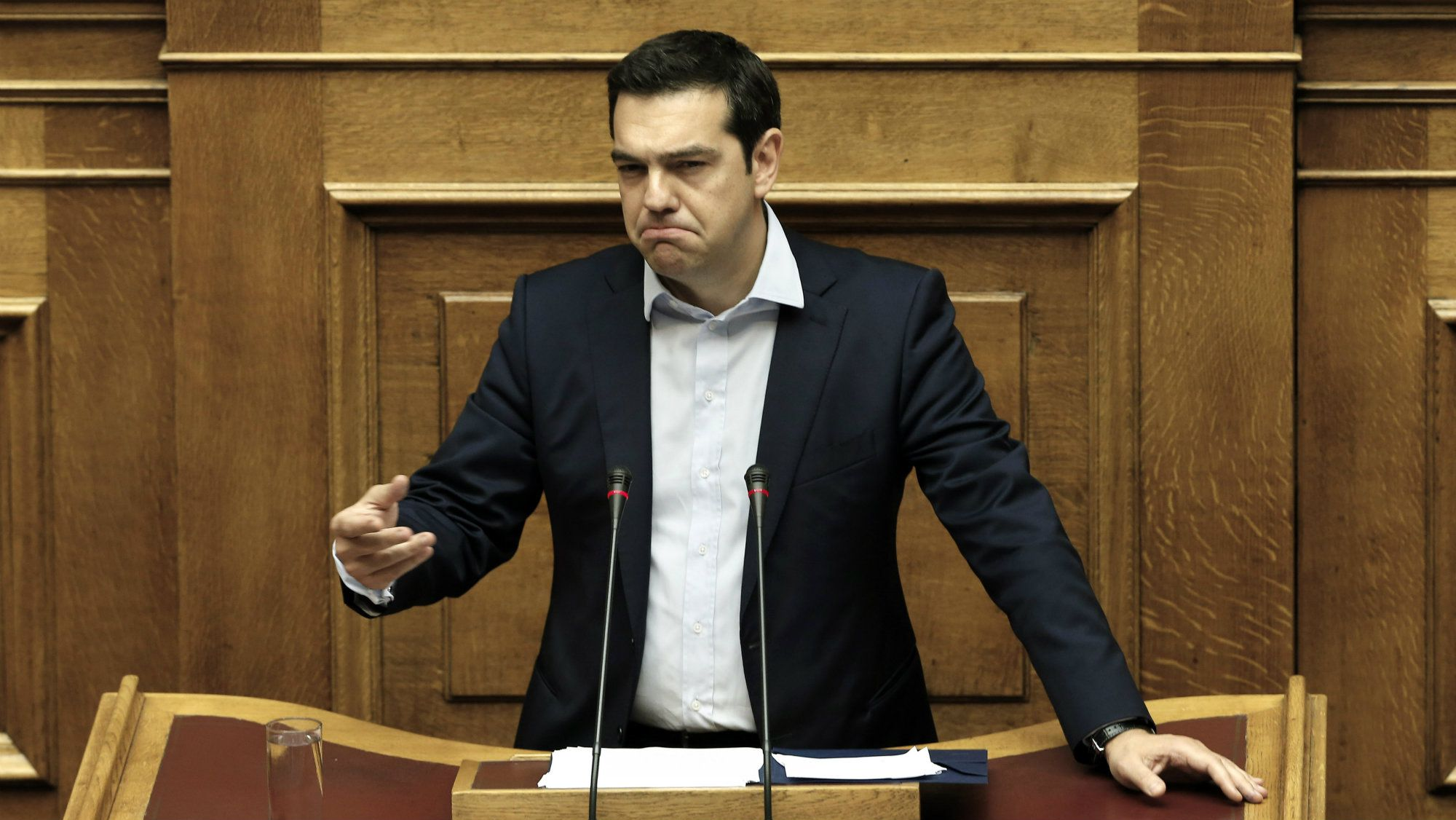 Greece's Prime Minister Alexis Tsipras delivers a speech to the lawmakers during an emergency Parliament session for the government's proposed referendum in Athens, Saturday, June 27, 2015.