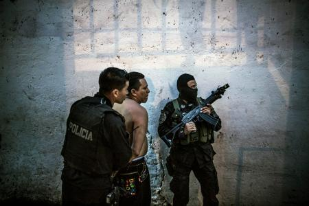 Members of the the fast response police unit detain a suspect