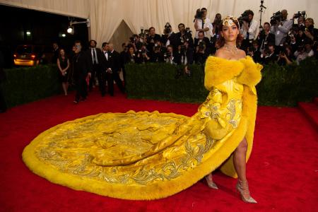 """Rihanna arrives at The Metropolitan Museum of Art's Costume Institute benefit gala celebrating """"China: Through the Looking Glass"""" on Monday, May 4, 2015, in New York."""