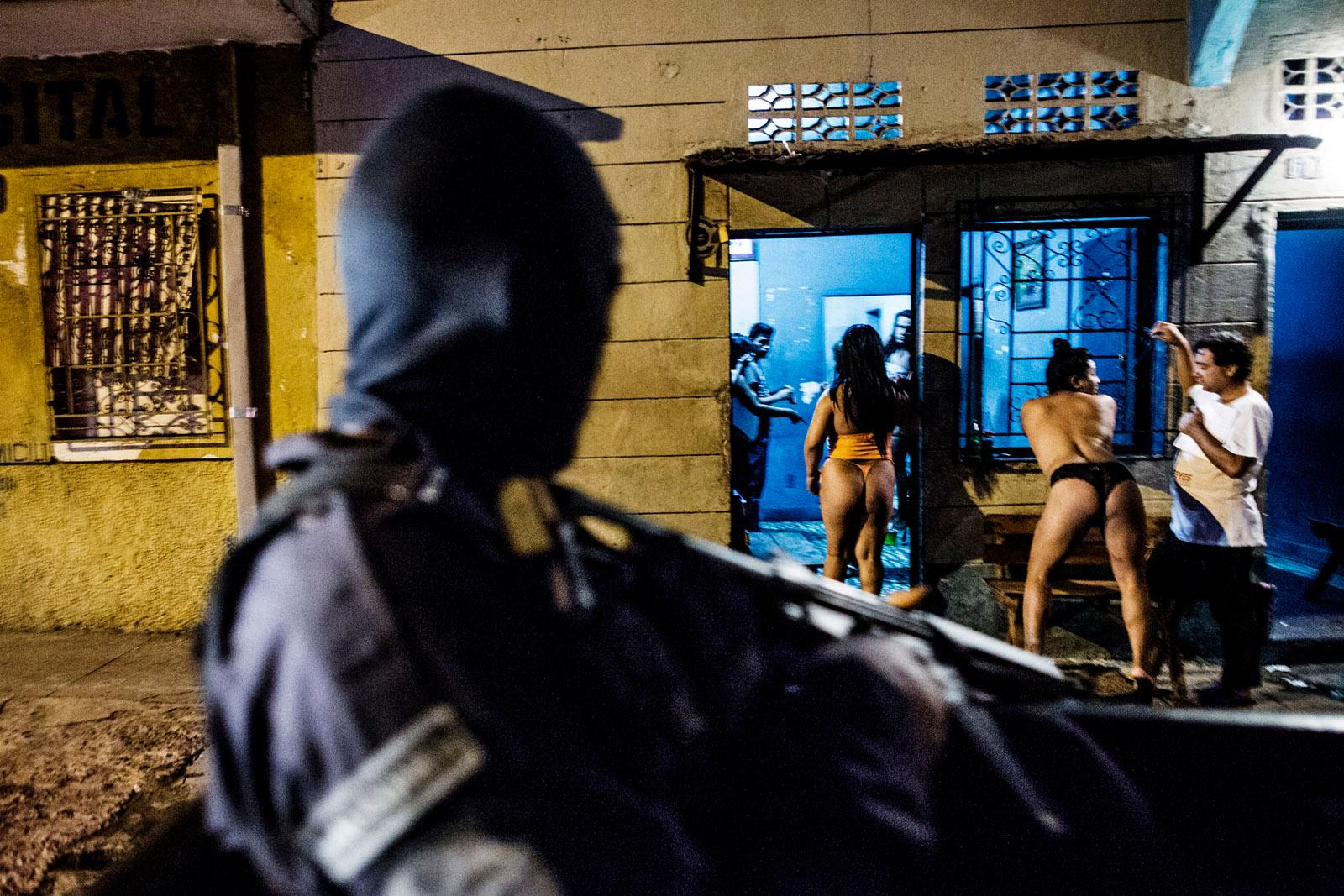 A police patrol drives past a brothel in San Salvador