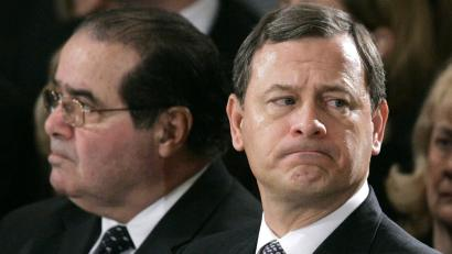 Supreme Court Chief Justice John Roberts, right, and Associate Justice Antonin Scalia.