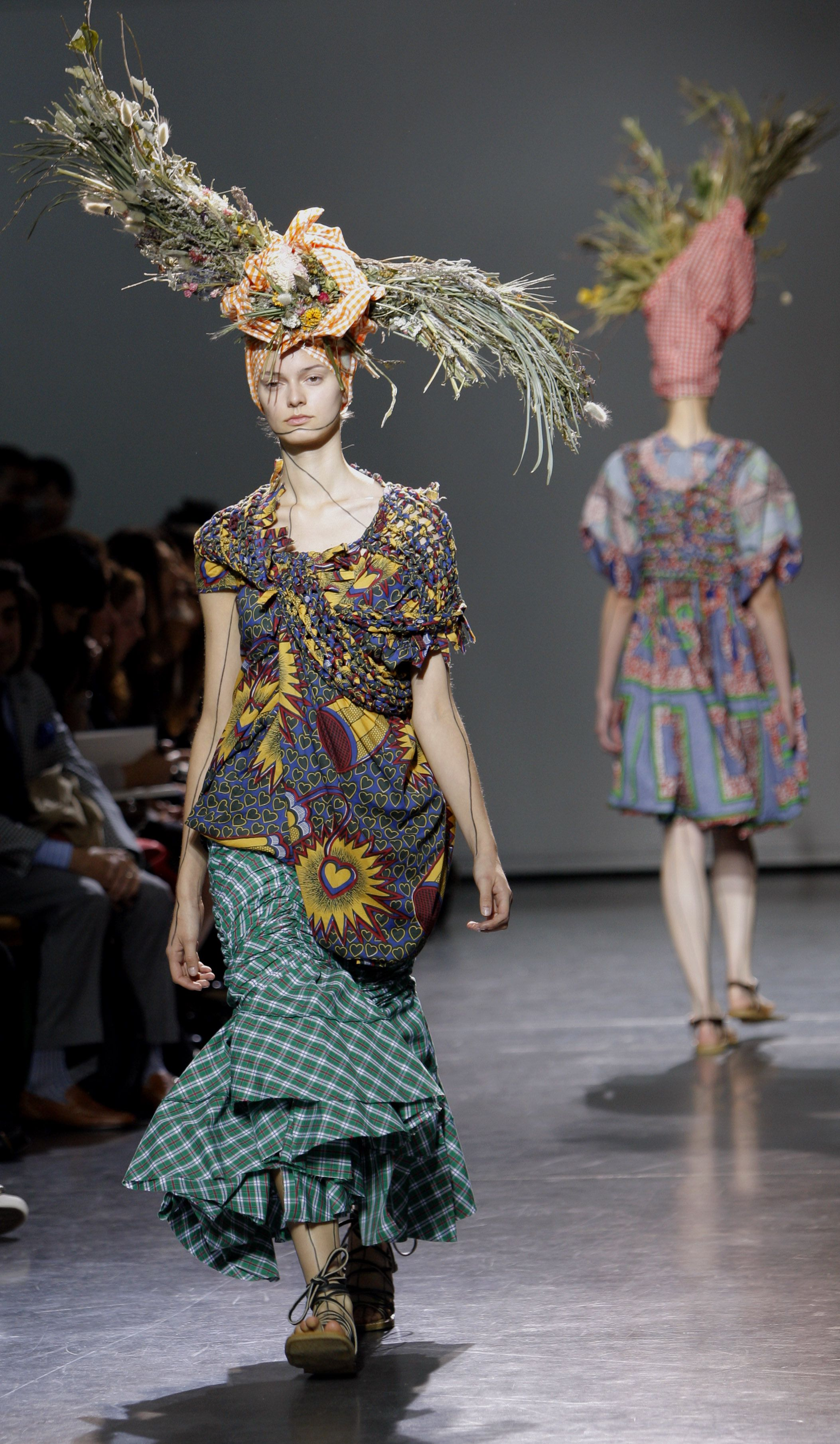 Models wear creations by Japanese fashion designer Junya Watanabe during his spring-summer 2009 ready-to-wear collection presented in Paris, Tuesday, Sept. 30, 2008.