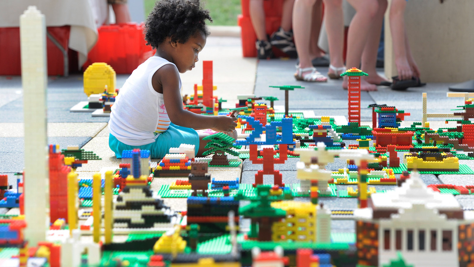 IMAGE DISTRIBUTED FOR LEGO - LEGO Maker Glo Banks, of Washington, helps build a 30-by-50-foot map of the United States at the National Maker Faire at the University of the District of Columbia in Washington, Saturday, June 13, 2015. Thousands of LEGO makers used the iconic bricks to build the LEGO Maker Nation.
