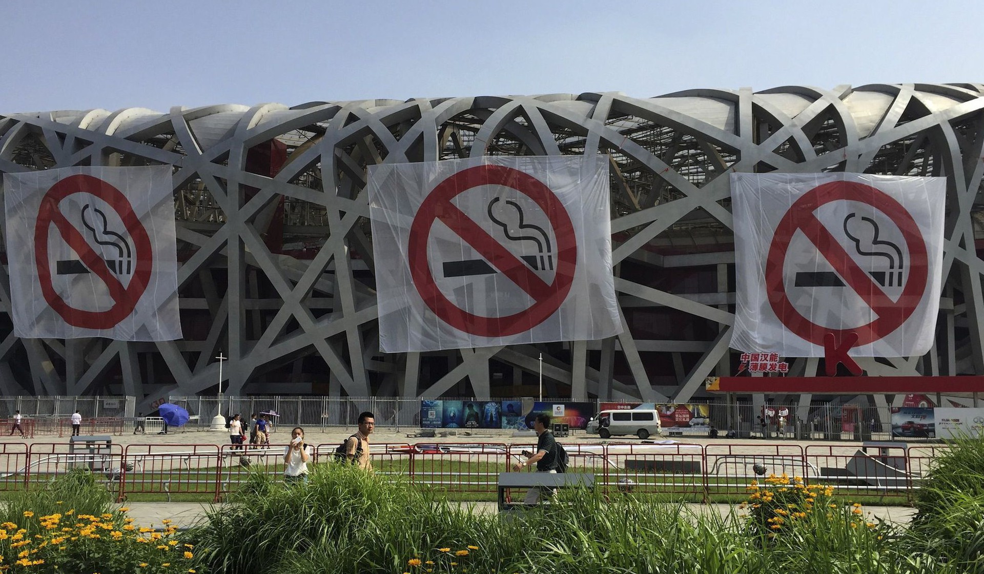 "Giant ""No-smoking"" signs are seen on the exterior of the National Stadium, also known as the Birds' Nest, as part of an anti-smoking campaign, in Beijing, China, May 30, 2015. Beijing will ban smoking in restaurants, offices and on public transport from Monday, part of unprecedented new curbs welcomed by anti-tobacco advocates, though how they will be enforced remains to be seen. Picture taken May 30, 2015. REUTERS/Stringer CHINA OUT. NO COMMERCIAL OR EDITORIAL SALES IN CHINA - RTR4Y6BN"