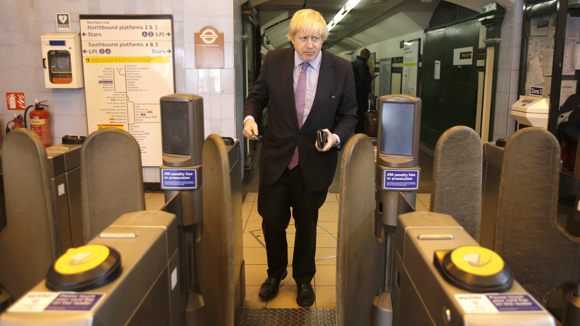 London's Mayor, Boris Johnson arrives at Golders Green underground station while campaigning in support of the prospective parliamentary candidate for Hendon, Mike Freer, in north London, April 30, 2015. REUTERS/Peter Nicholls