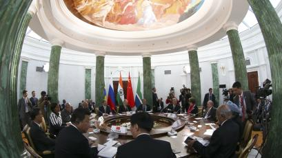 Participants sit at a table during a BRICS leaders' meeting at the 2013 G20 Summit in Strelna, Russia.