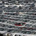 Cars produced at the Subaru of Indiana Automotive Manufacturing Plant in Lafayette, Ind., sit in a holding lot outside the factory Saturday, Feb. 28, 2009.
