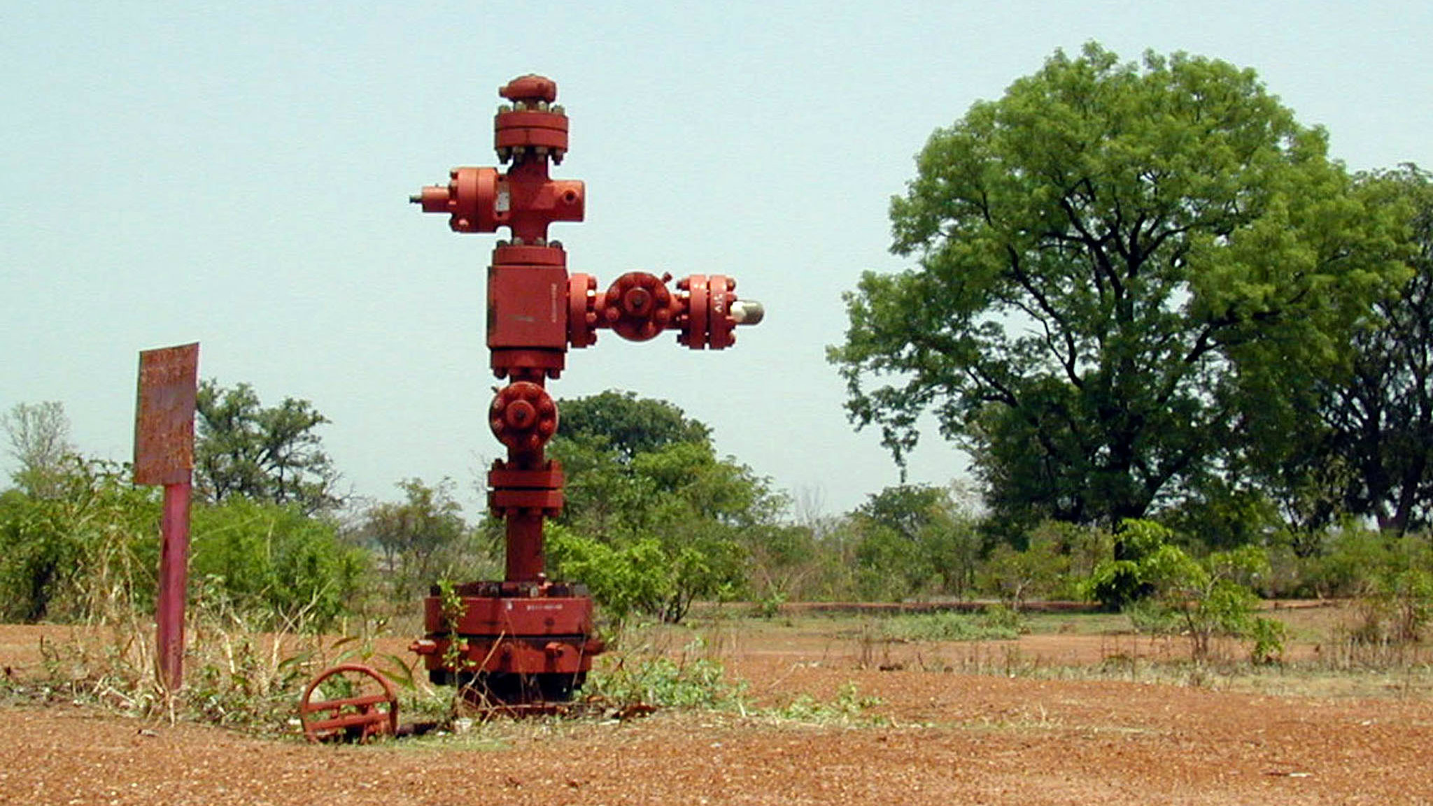The well-head of one of the first exploratory oil wells sunk in southern Chad in 1974 stands in a forest clearing near the village of Niandoum. Plans by a foreign consortium for a pipeline to carry oil more than 1,000 km (650 miles) to the Atlantic promises to transform the economy of the impoverished Central African country. Picture taken May 18, 2001