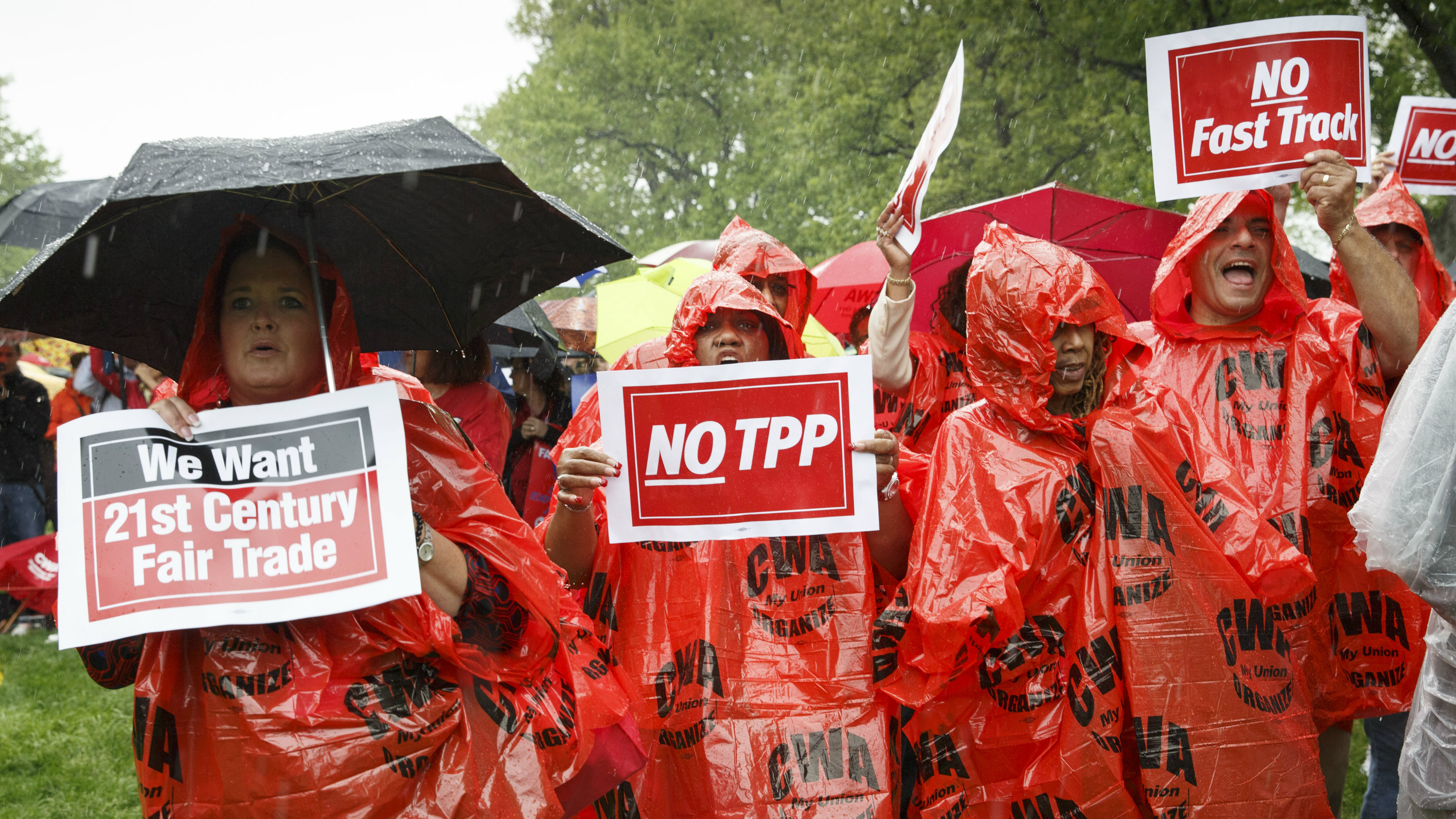 Demonstrators rally for fair trade at the Capitol in Washington, Wednesday, May 7, 2014. The signs refer to the proposed expansion of the Trans-Pacific Partnership, TPP, and, to fast track negotiating authority, also called trade promotion authority or TPA, for trade agreements negotiated by the president.