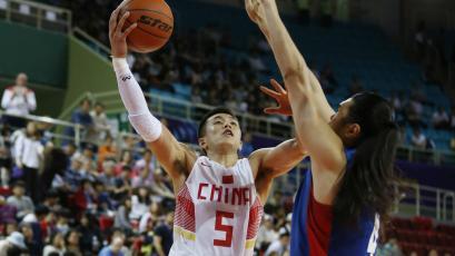 Taiwan's Tseng Wen Ting, right, tries to block a shot by China's Guo Ailun during the men's preliminary round basketball match at the 17th Asian Games in Incheon, South Korea.