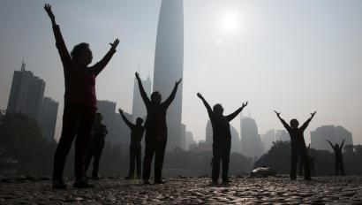 """DATE IMPORTED:February 12, 2015Residents do morning exercises at a park on a hazy day in Shenzhen, Guangdong province February 12, 2015. Nearly 90 percent of China's big cities failed to meet air quality standards in 2014, but that was still an improvement on 2013 as the country's """"war on pollution"""" began to take effect, the environment ministry said on February 2. REUTERS/Stringer"""