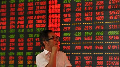 An investor looks at an electronic board showing stock information at a brokerage house in Fuyang, Anhui province, China, June 12, 2015. Picture taken June 12, 2015. REUTERS/China Daily