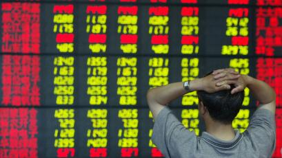 A Chinese investor monitors stock prices at a securities firm in Shanghai.