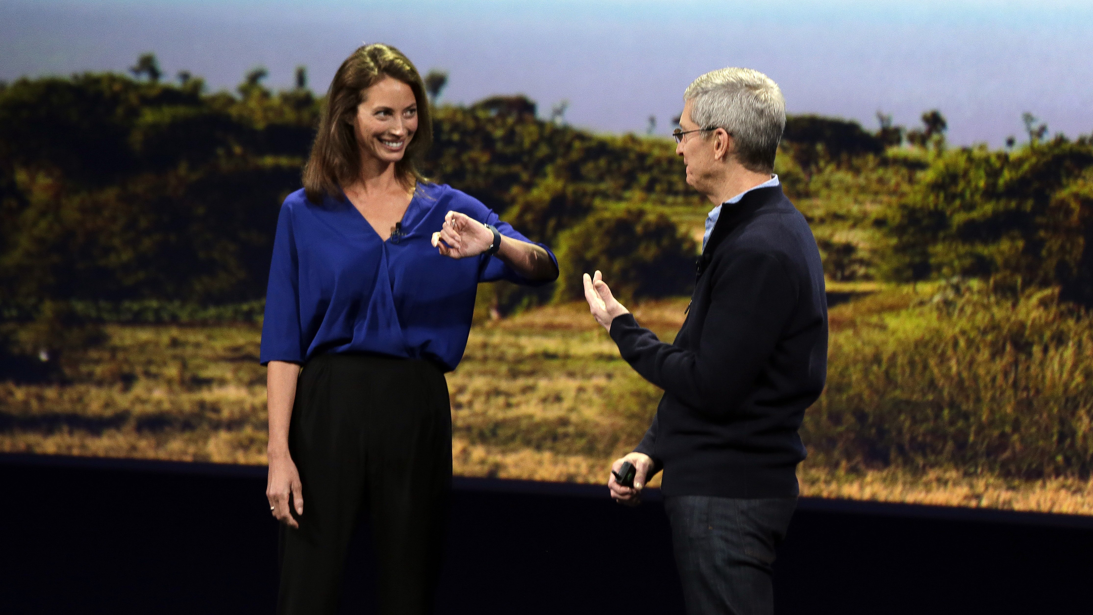Apple CEO Tim Cook, right, and Christy Turlington Burns, founder of Every Mother Counts, discuss the new Apple Watch on Monday, March 9, 2015, in San Francisco, Calif. (AP Photo/Eric Risberg)