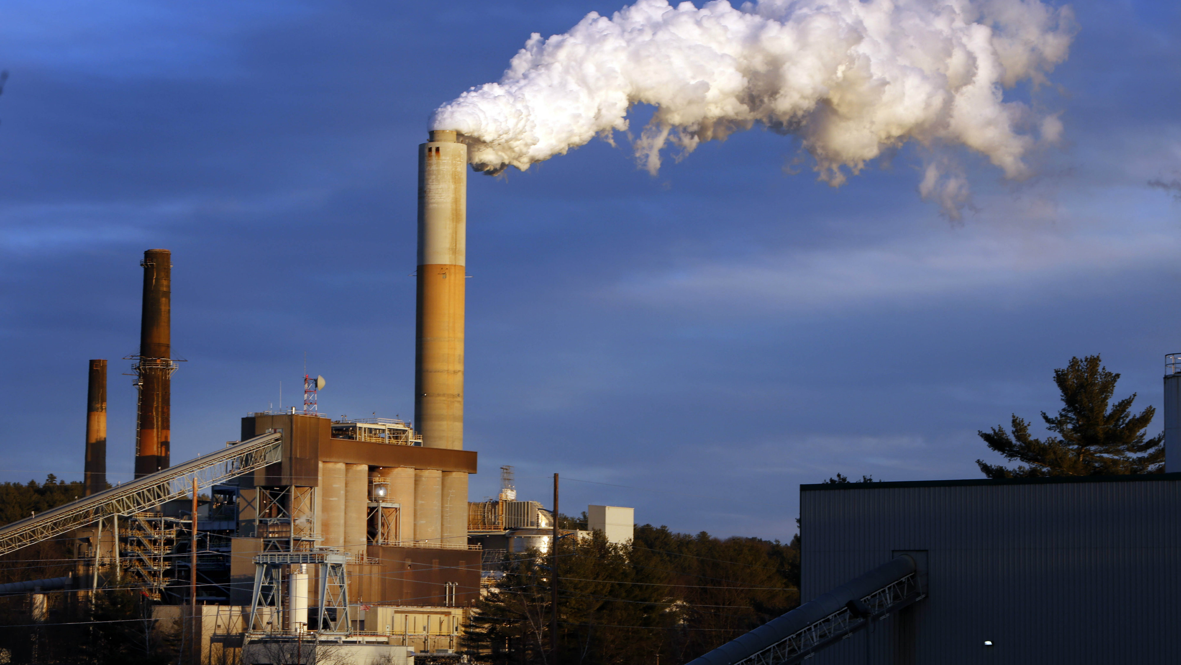 A plume of steam billows from the coal-fired Merrimack Station in Bow, N.H., on Jan. 20, 2015.