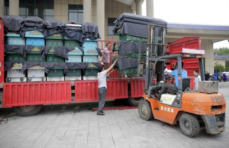 A forklift unloads a truck of coffins at a mortuary after a cruise ship sank on the Yangtze River in Jianli, Hubei province, China, June 3, 2015.