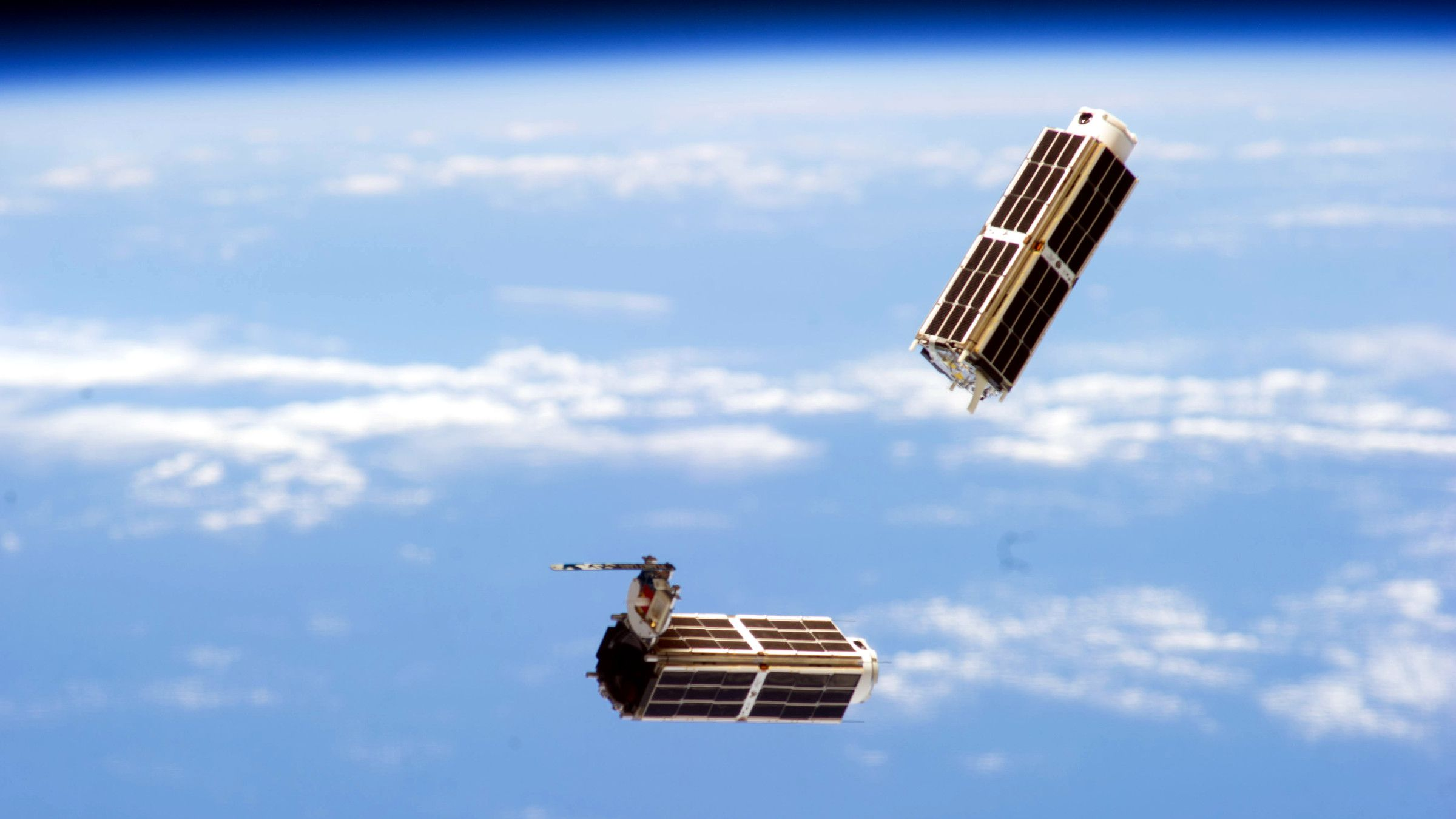 A set of NanoRacks CubeSats is photographed by an Expedition 38 crew member after the deployment by the Small Satellite Orbital Deployer (SSOD). The CubeSats program contains a variety of experiments such as Earth observations and advanced electronics testing.