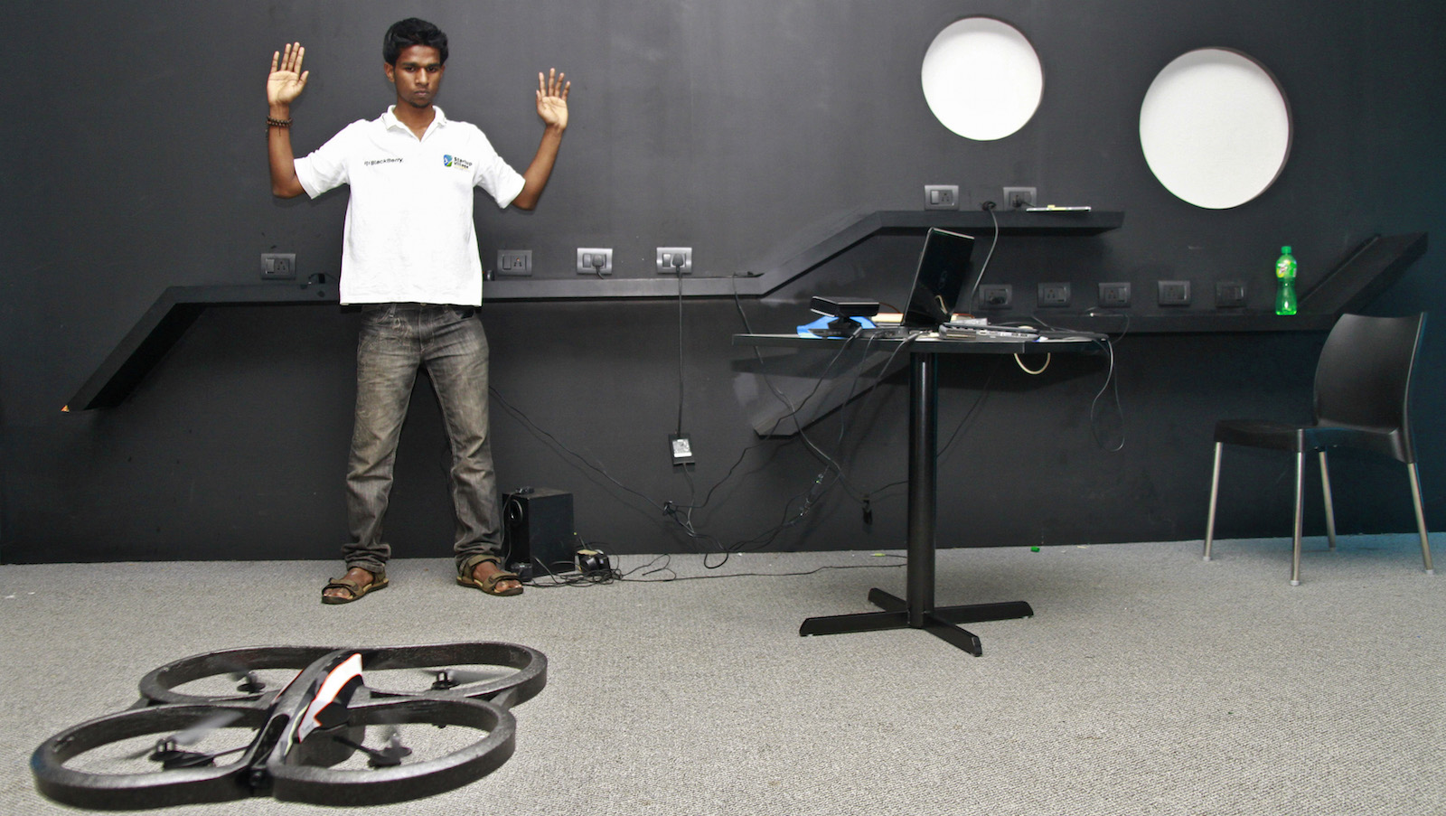 Vivek, an engineering student, demonstrates as he tries to control a Quad-copter with his hand at the Start-up Village in Kinfra High Tech Park in the southern Indian city of Kochi October 13, 2012. Three decades after Infosys, India's second-largest software service provider, was founded by middle-class engineers, the country has failed to create an enabling environment for first-generation entrepreneurs. Startup Village wants to break the logjam by helping engineers develop 1,000 Internet and mobile companies in the next 10 years. It provides its members with office space, guidance and a chance to hobnob with the stars of the tech industry. But critics say this may not even be the beginning of a game-changer unless India deals with a host of other impediments - from red tape to a lack of innovation and a dearth of investors - that are blocking entrepreneurship in Asia's third-largest economy. Picture taken October 13, 2012.