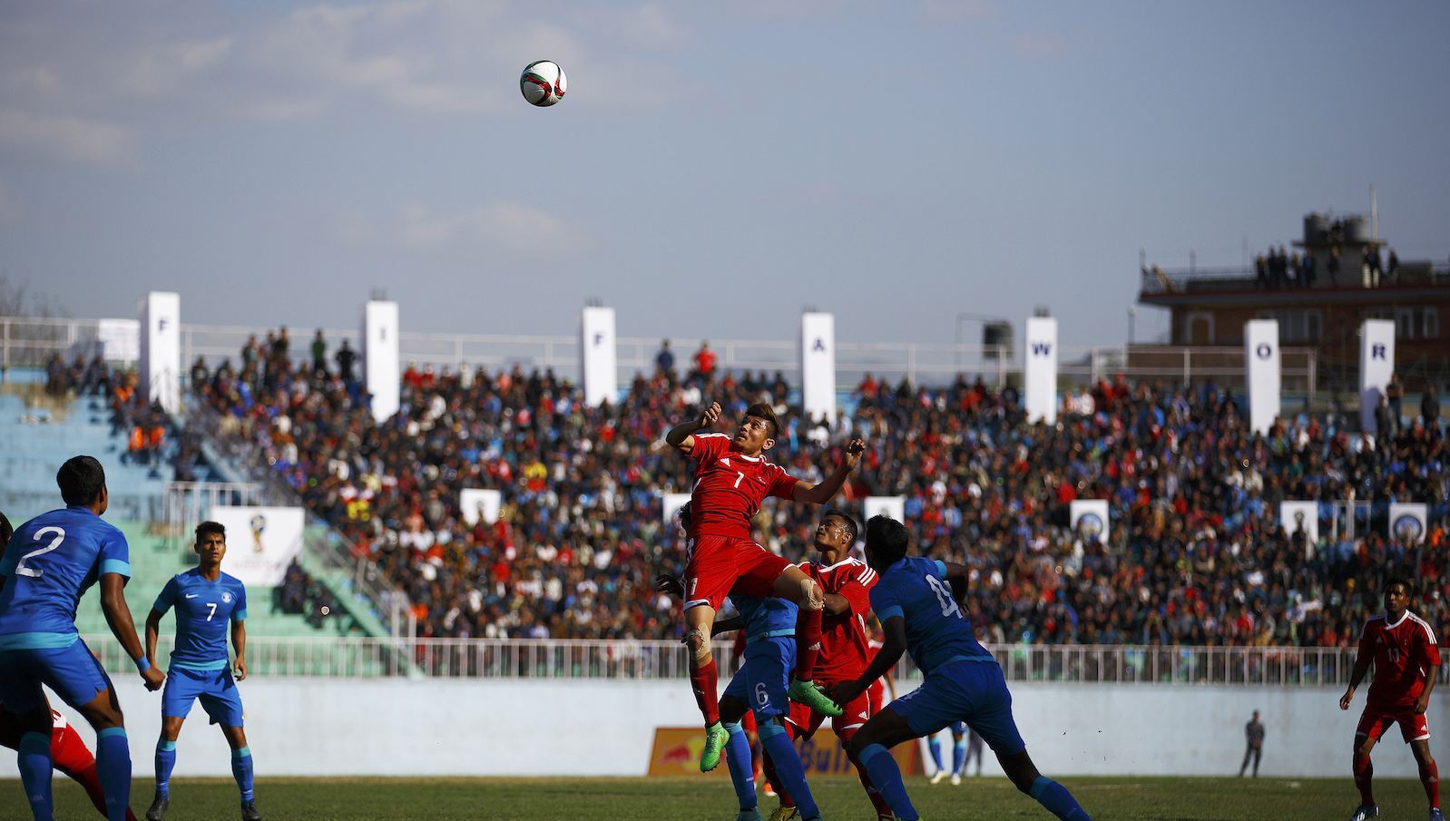 Nepal's striker Bimal Gharti Magar (top) is surrounded by India's players as he tries to head a ball during their 2018 World Cup qualifying match in Kathmandu March 17, 2015.