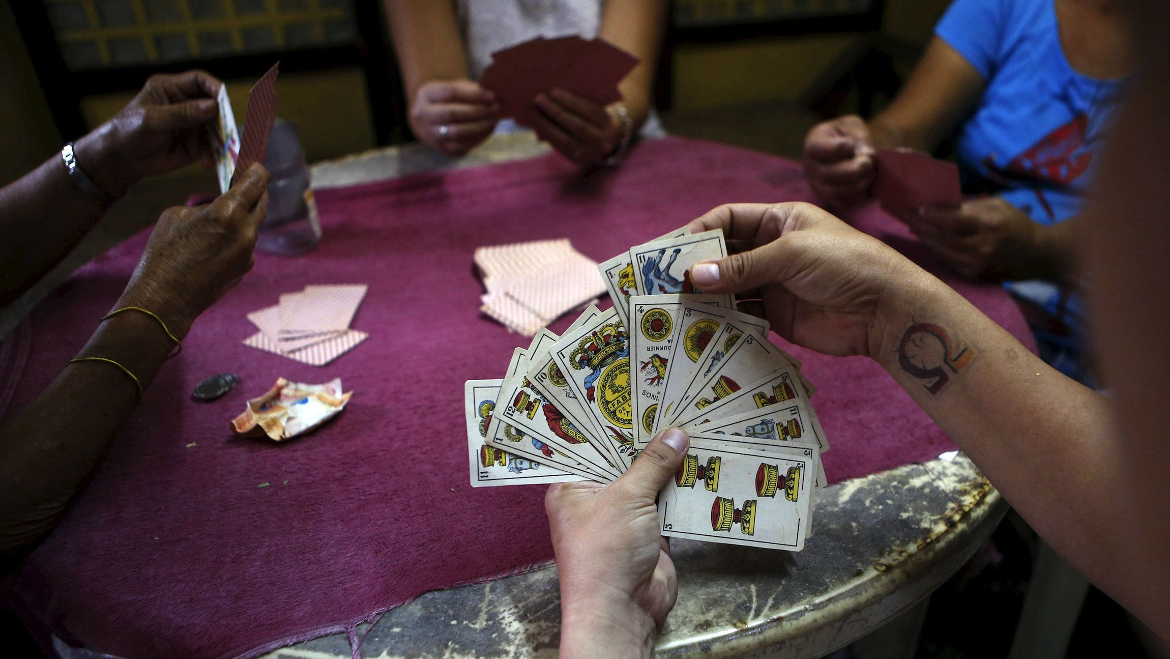 """Locals play a Spanish card game known as """"sakla"""" in an underground casino in Manila."""