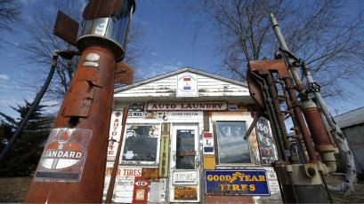An old closed up gas station is seen in Belle Plaine, Iowa.