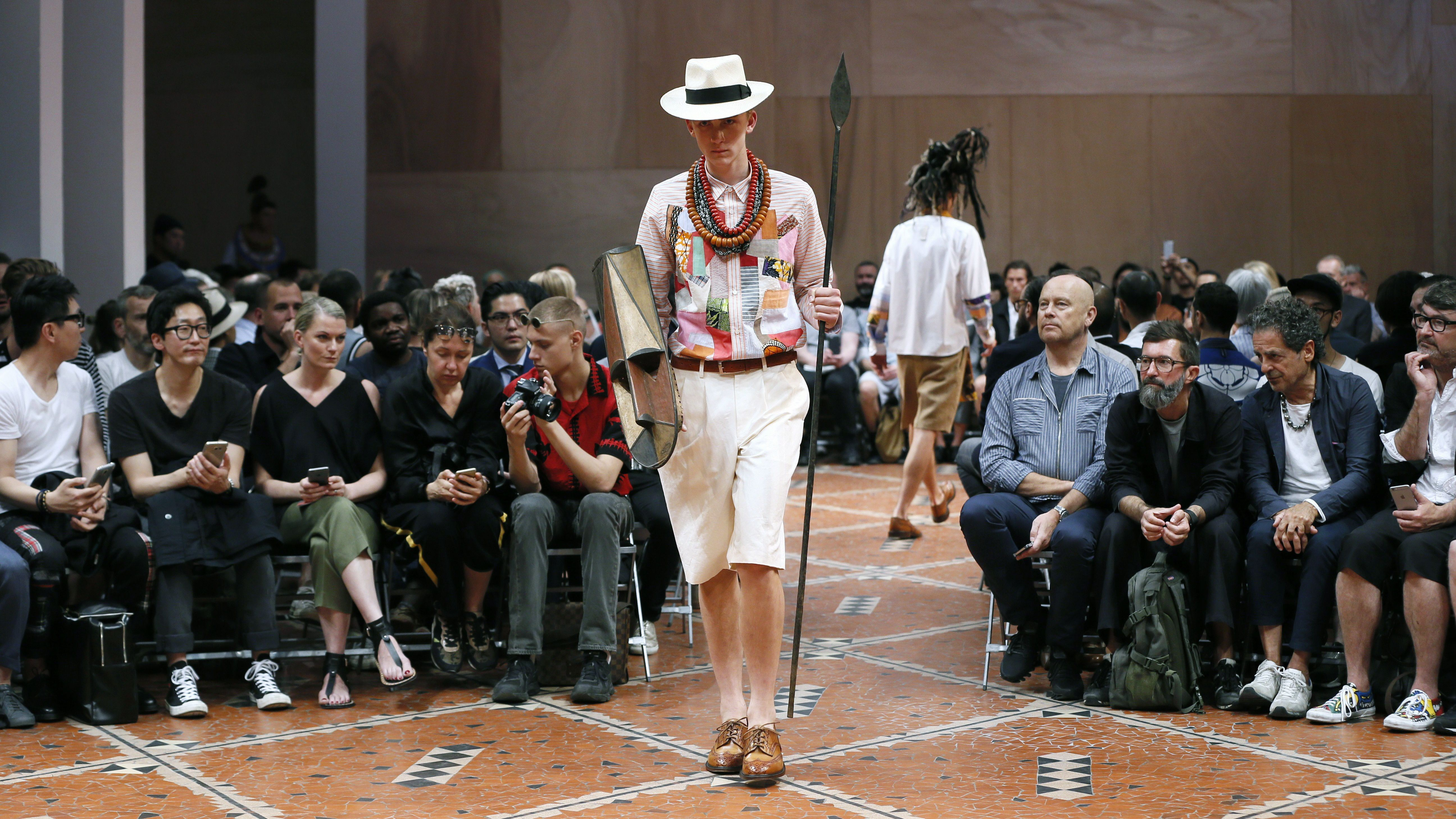 A model presents a creation by Japanese designer Junya Watanabe during the men's Spring Summer collection fashion shows in Paris on June 26, 2015.