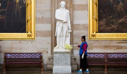 Maria Bernal de Navarrette cleans a statue of Alexander Hamilton, a Founding Father of the United States, in Rotunda on Capitol Hill in Washington October 15, 2013. Republicans in the House of Representatives failed to reach internal consensus on Tuesday on how to break an impasse on the federal budget that could soon result in an economically damaging default on the country's debt. REUTERS/Joshua Roberts (UNITED STATES - Tags: POLITICS BUSINESS EMPLOYMENT) - RTX14COM