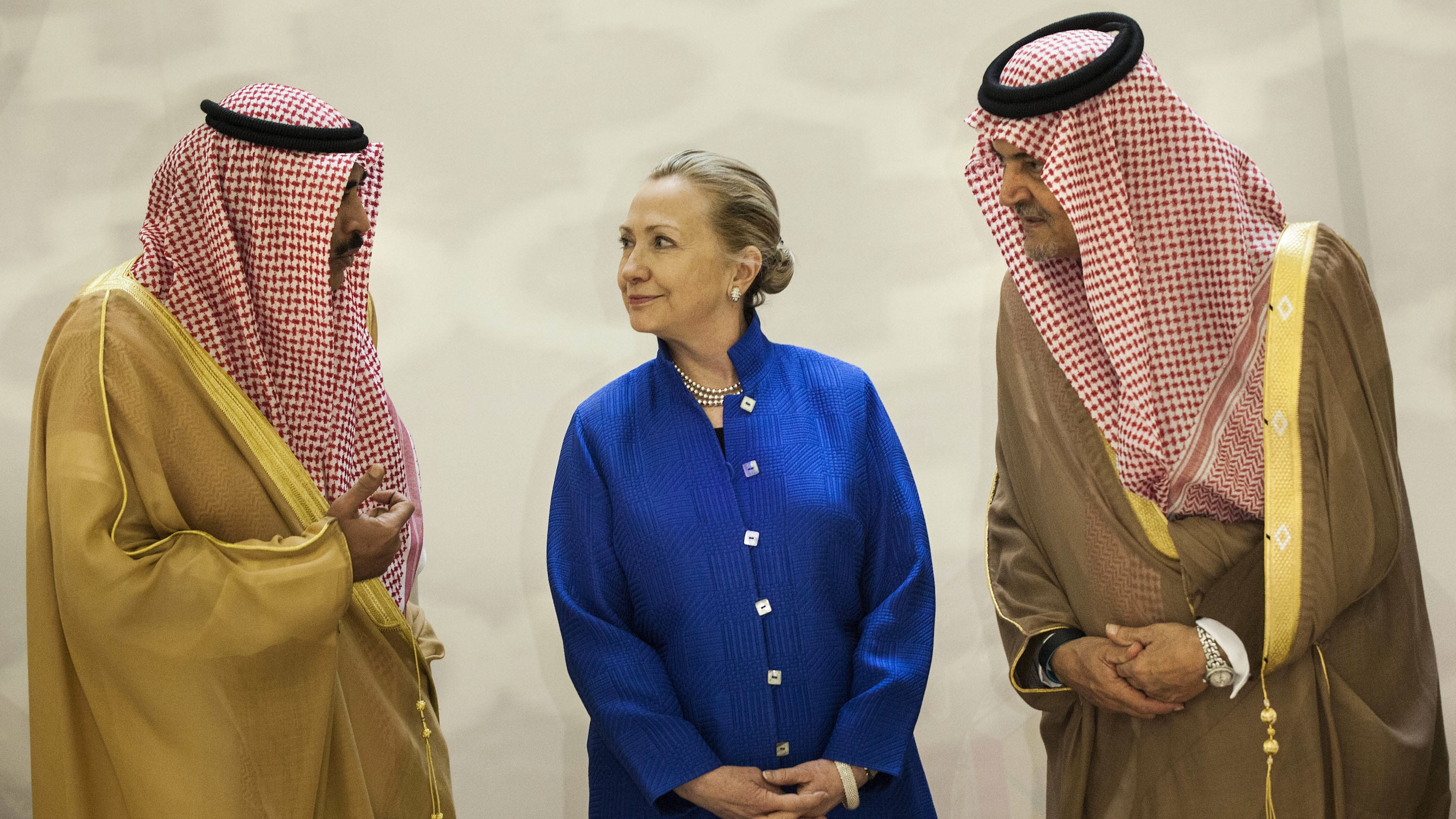 Saudi foreign minister Prince Saud al-Faisal, right, US secretary of state Hillary Clinton and Kuwaiti foreign minister Sheikh Sabah Khaled al-Hamad al-Sabah chat prior to a group photo before a US-Gulf Cooperation Council forum at the Gulf Cooperation Council Secretariat in Riyadh, Saudi Arabia, Mar. 2012.