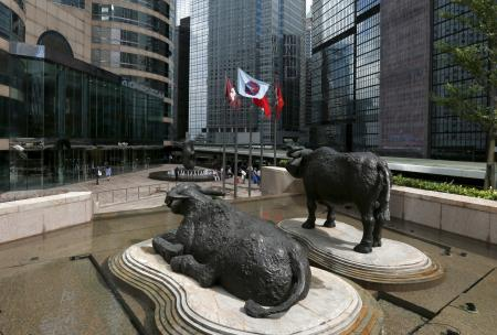 Two water buffalo sculptures by British artist Elisabeth Frink are seen outside Exchange Square business tower where the Hong Kong Stock Exchange is located