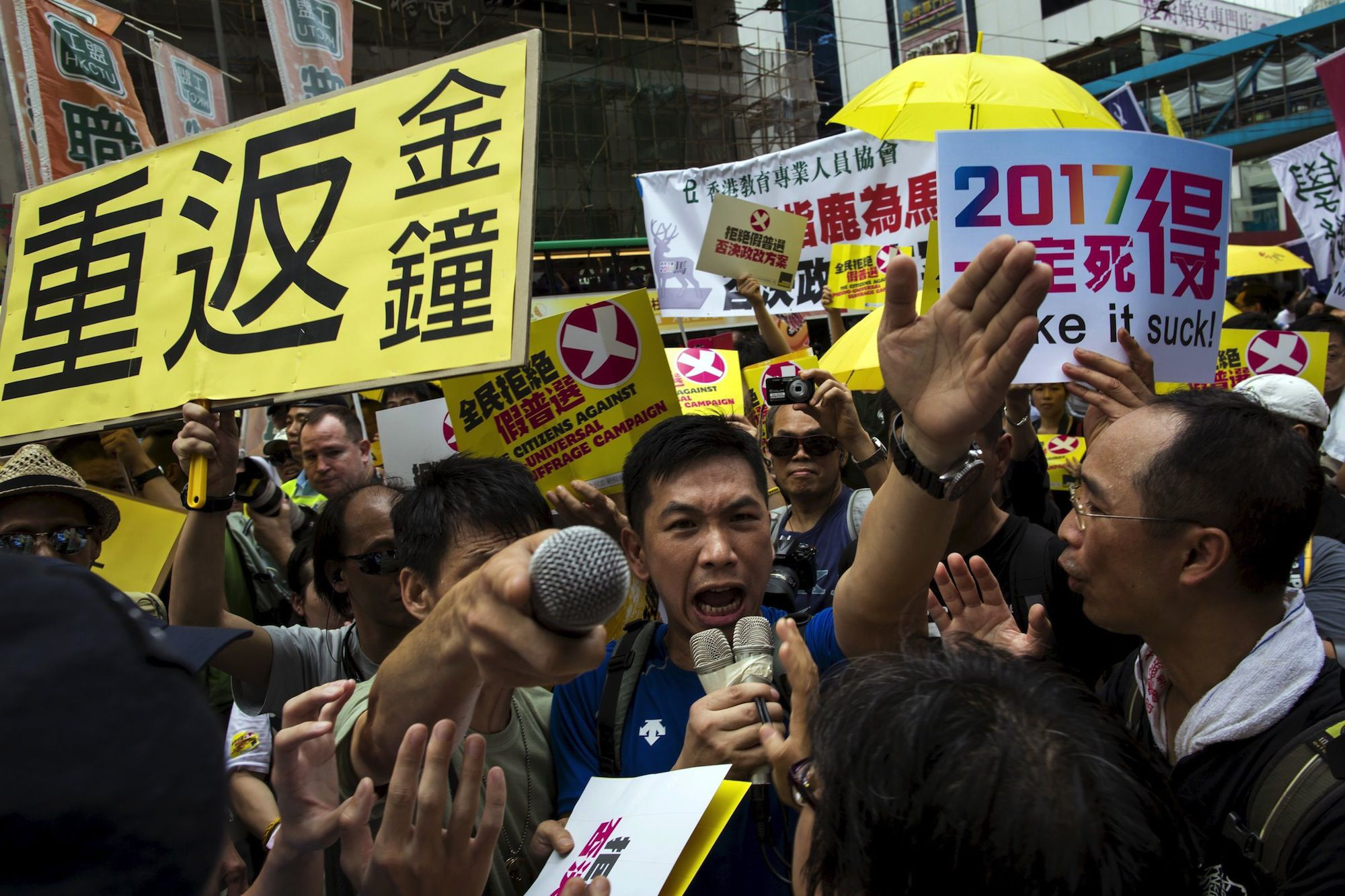 Pro-democracy protesters shout at pro-China supporters at a rally in Hong Kong on June 14th.