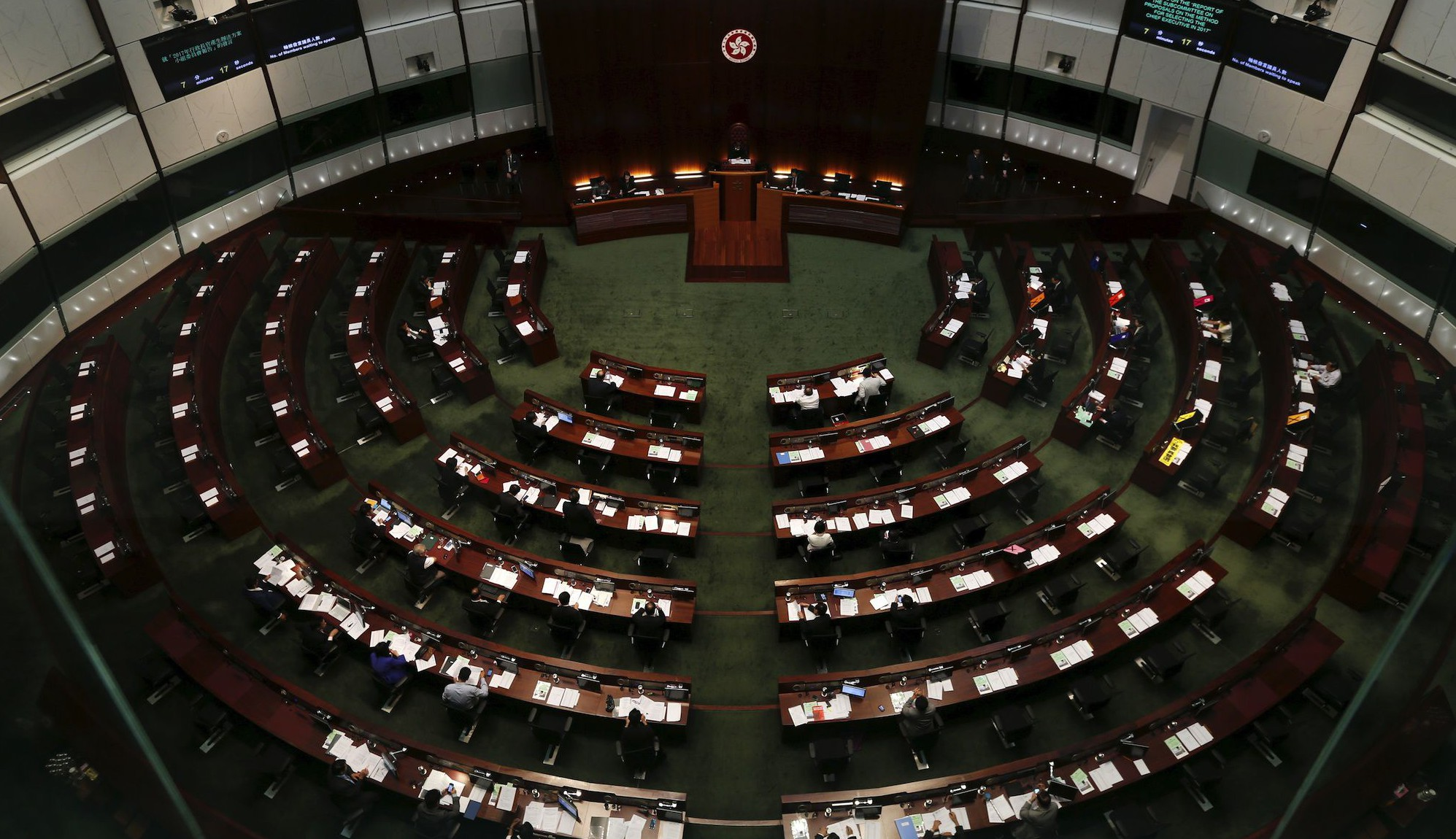A general view of a Legislative Council meeting before a Beijing-backed electoral reform is debated in Hong Kong, China June 17, 2015. More than a thousand people converged on Hong Kong's Legislative Council early on Wednesday before lawmakers debate a Beijing-backed electoral reform plan that could trigger fresh protests in the Chinese-controlled city.