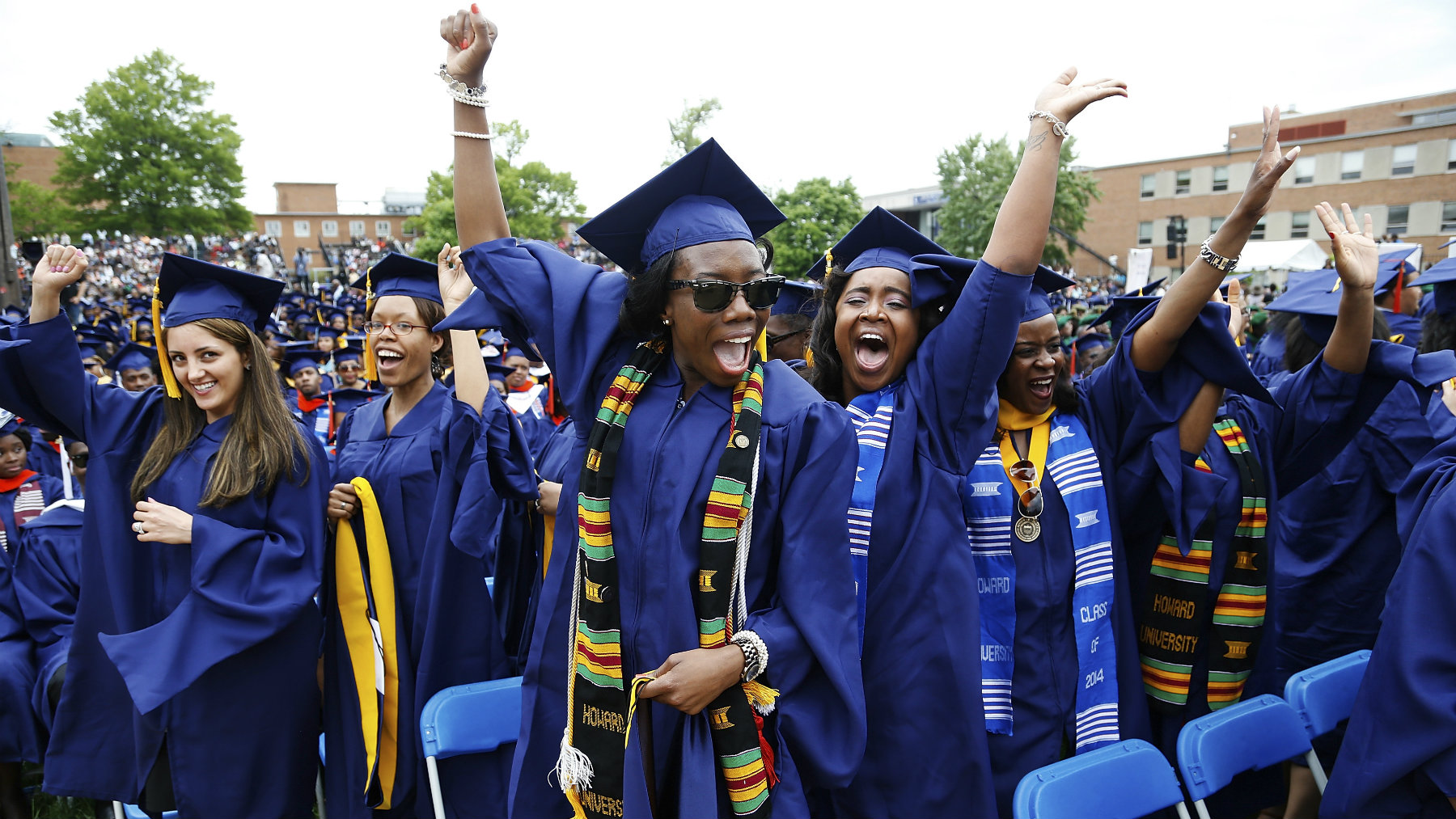 Graduates celebrate during the 2014 graduation ceremonies at Howard University in Washington May 10, 2014. Entertainer Sean Combs delivered the commencement address and received an honorary degree in Humanities during the ceremony. REUTERS/Jonathan Ernst (UNITED STATES - Tags: EDUCATION ENTERTAINMENT SOCIETY)