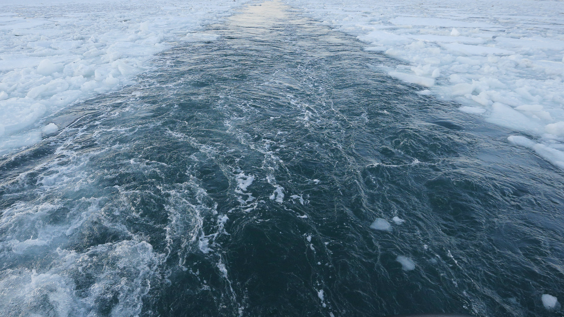 The Warren Jr., a 150 foot offshore supply boat, cuts a path through the ice as it works as an ice breaker for the commuter ferry in the waters off Hingham, Massachusetts, March 3, 2015. With its black hull rumbling against a field of broken ice, the Warren Jr. slowly eased away from a dock in the Boston suburb of Hingham on Tuesday, aiming to clear a path for some of the four ferries that carry commuters from here into the city each day. But in a sign of how long Massachusetts has been gripped by freezing temperatures, no other vessels followed, as the tide narrowed the channel behind the ocean-going supply boat pressed into service as an icebreaker. It was the 15th day of canceled ferry service since late January and the outing was meant to speed the fleet's return to service, which could still be days away. REUTERS/Brian Snyder (UNITED STATES - Tags: ENVIRONMENT TRANSPORT)