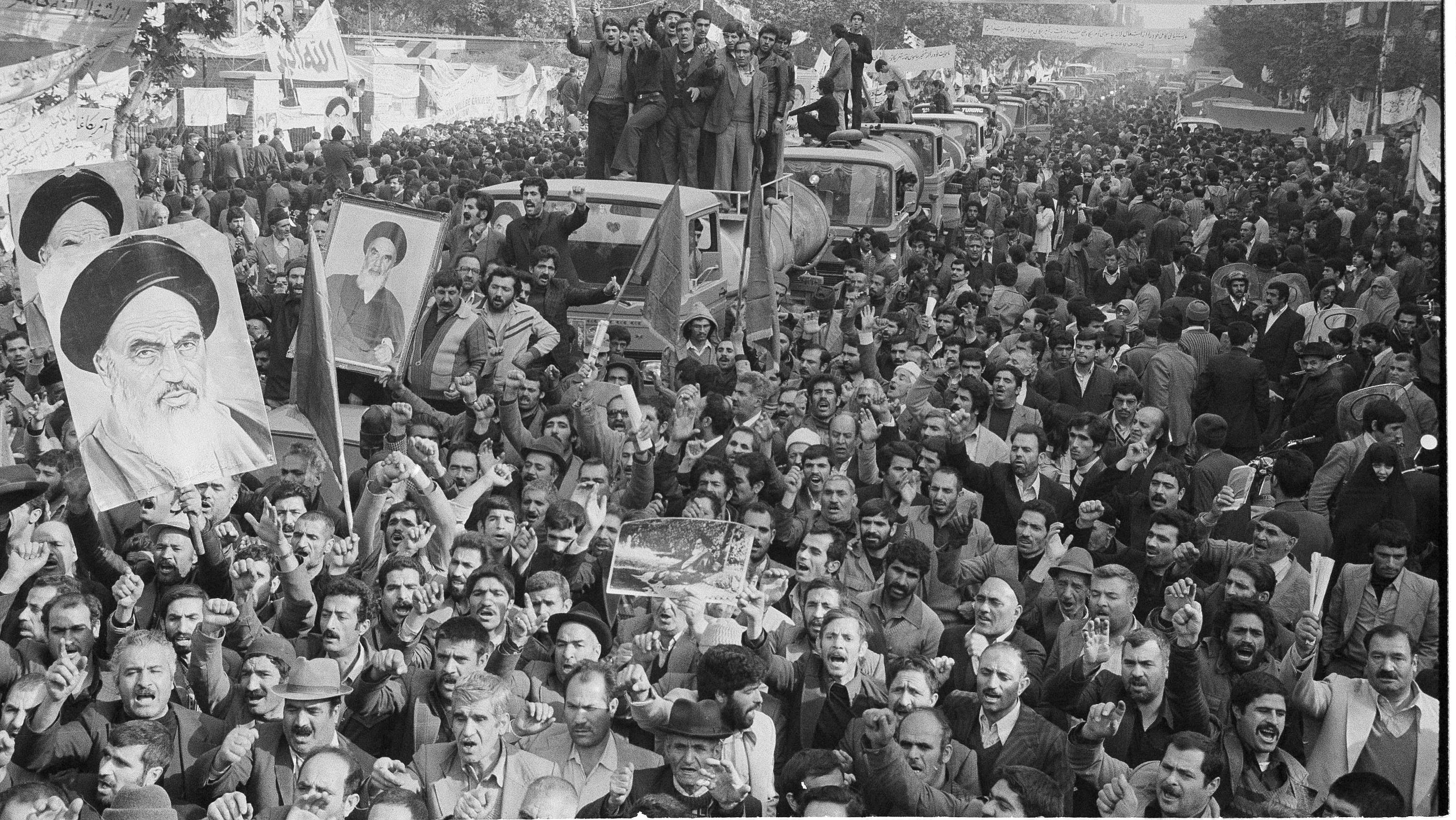 This is a general view outside the U.S. Embassy in Tehran, Nov. 27, 1979, showing demonstrators, including oil tank drivers with their vehicles..