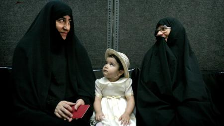 Iranian women wait to cast their votes in the second round of the Iranian presidential election in Tehran June 24, 2005.